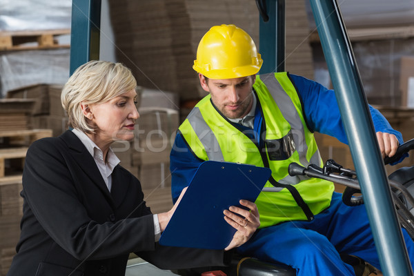 Forklift driver talking with his manager Stock photo © wavebreak_media