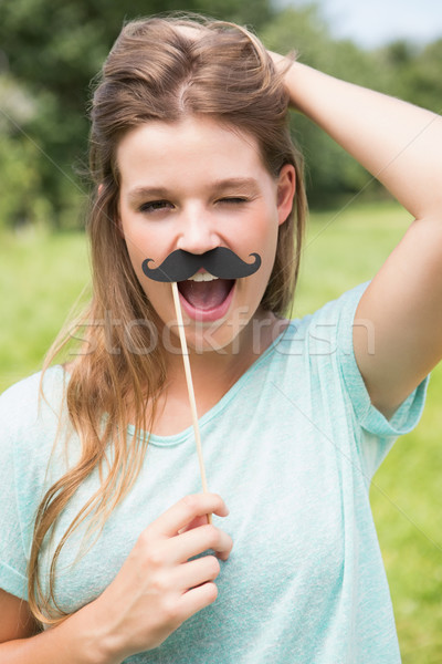 Bastante sonriendo cámara falso bigote Foto stock © wavebreak_media