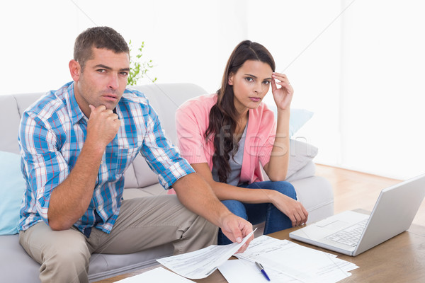Couple calculating home finances together in house Stock photo © wavebreak_media