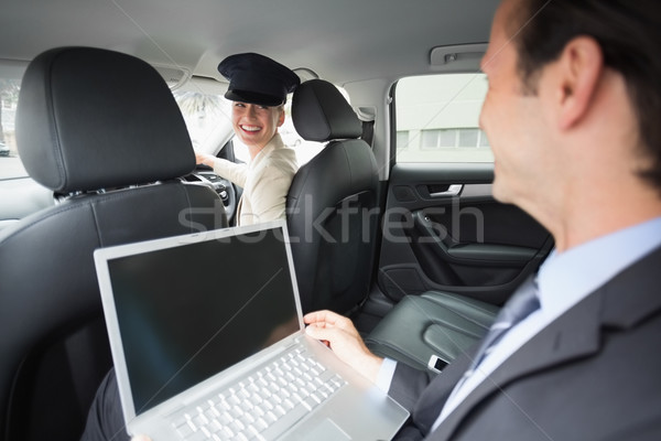 Businesswoman being chauffeured while working Stock photo © wavebreak_media