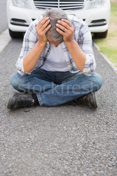 Stressed man sitting on the ground  Stock photo © wavebreak_media