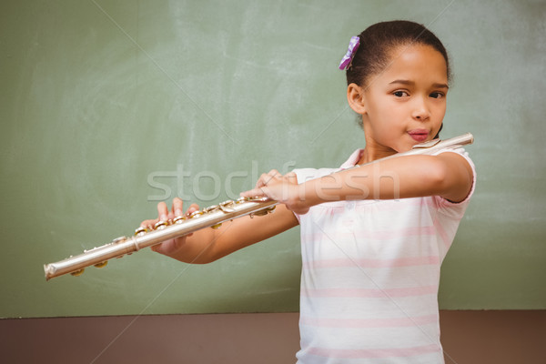 Küçük kız oynama flüt sınıf portre sevimli Stok fotoğraf © wavebreak_media