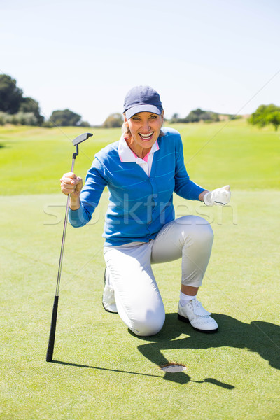 Excited lady golfer cheering on putting green  Stock photo © wavebreak_media