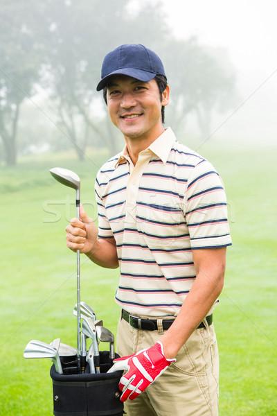 Feliz golfista toma club bolsa de golf campo de golf Foto stock © wavebreak_media