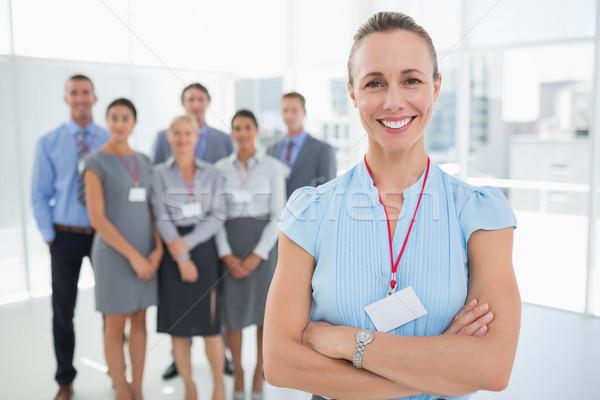 деловая женщина улыбаясь камеры команда за служба Сток-фото © wavebreak_media