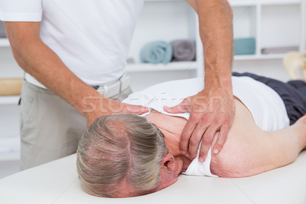 Schouder massage patiënt medische kantoor man Stockfoto © wavebreak_media