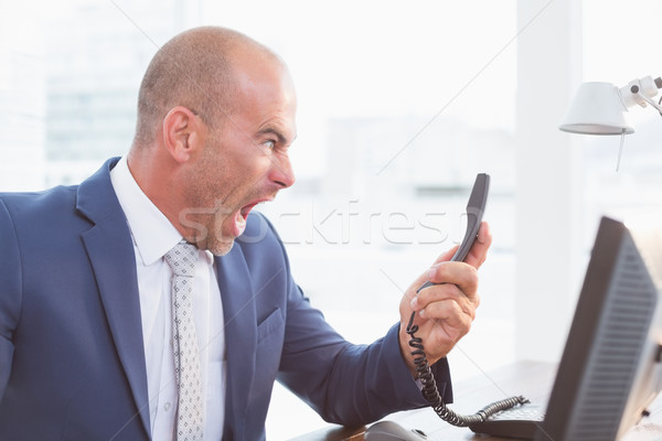 Businessman yelling at his phone Stock photo © wavebreak_media
