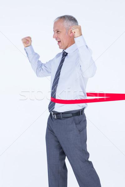 Happy businessman crossing red line  Stock photo © wavebreak_media
