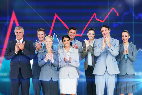 Composite image of smiling business team applauding at camera Stock photo © wavebreak_media