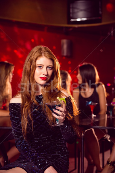Pretty redhead drinking a cocktail  Stock photo © wavebreak_media
