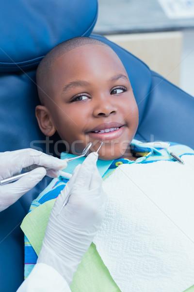 Stock photo: Close up of boy having his teeth examined