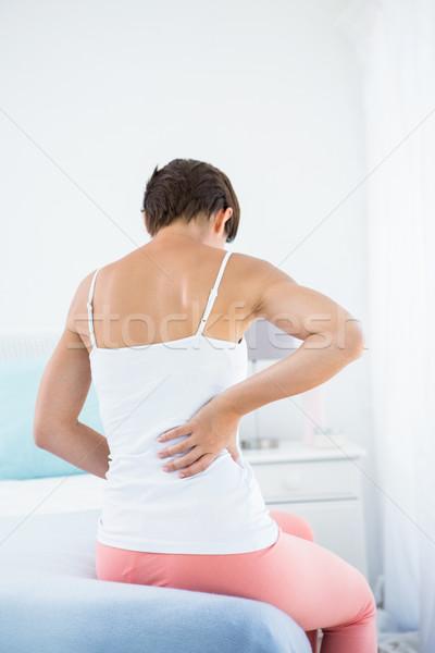 Mulher dor nas costas casa quarto corpo feminino Foto stock © wavebreak_media