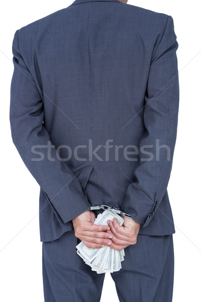 businessman in handcuffs holding bribe Stock photo © wavebreak_media