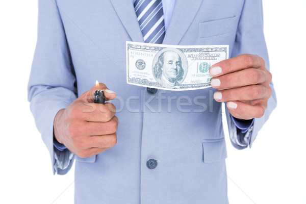 businessman burning a dollar banknote Stock photo © wavebreak_media