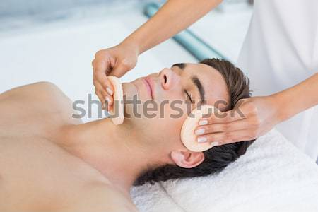 Attractive woman receiving facial massage at spa center Stock photo © wavebreak_media