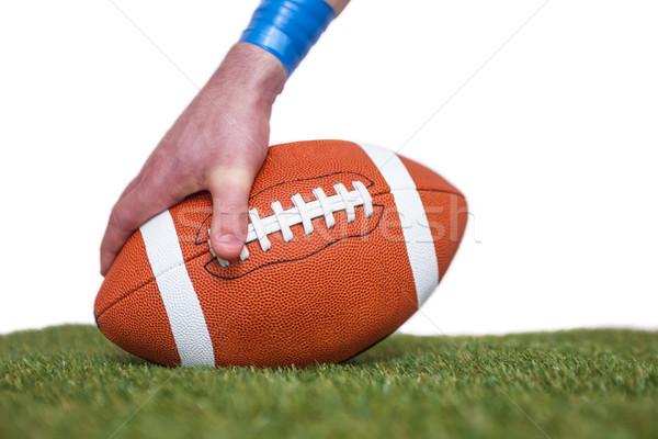 Amerikai futballista labda fű fehér kezek Stock fotó © wavebreak_media