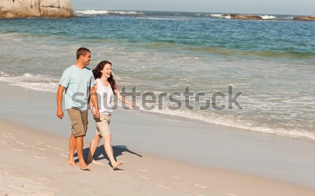 Rear view of woman with son walking on shore against clear sky Stock photo © wavebreak_media