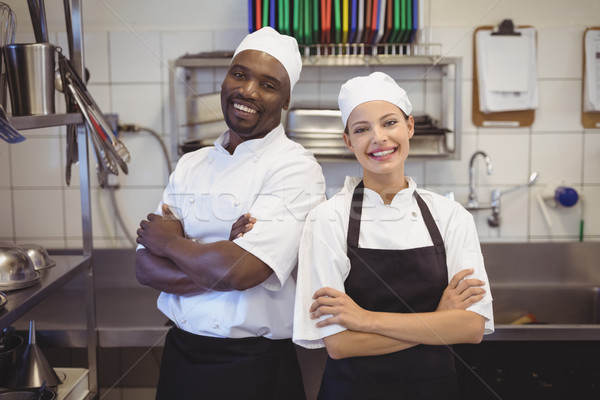 Two chefs standing with arms crossed in the commercial kitchen Stock photo © wavebreak_media