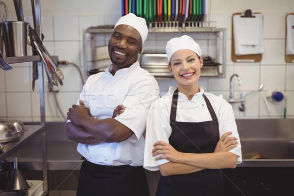 Deux chefs permanent commerciaux cuisine Photo stock © wavebreak_media