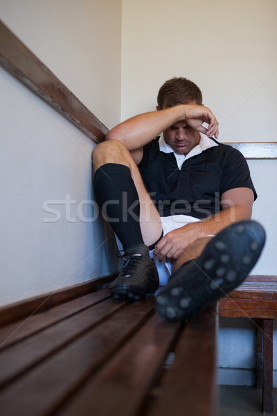 Tired rugby player sitting on wooden bench Stock photo © wavebreak_media