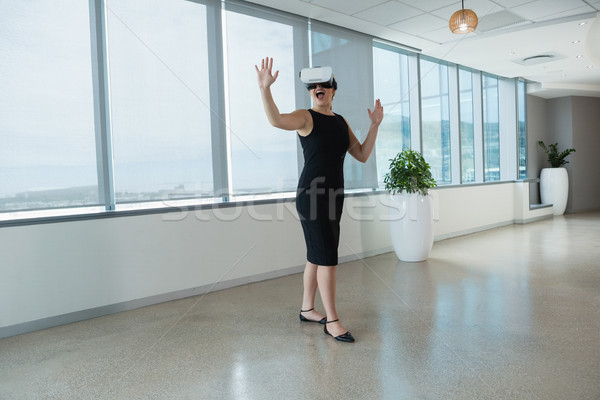 Female executive using virtual reality headset in office Stock photo © wavebreak_media