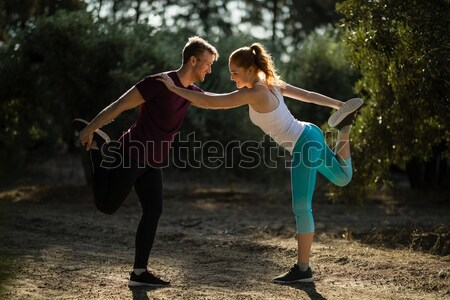 Group of fit women carrying a heavy wooden log during obstacle course training Stock photo © wavebreak_media