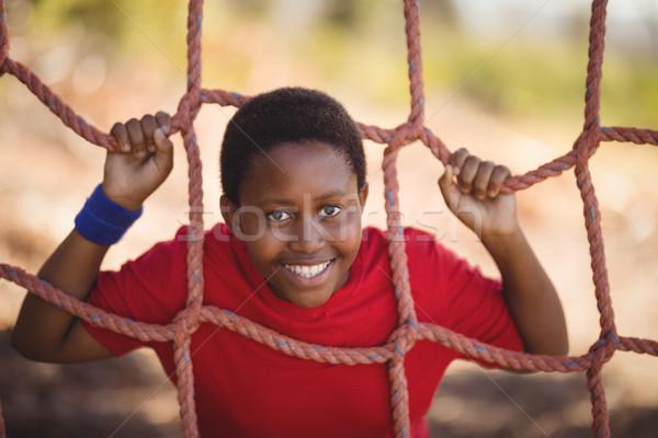 Portré vidám fiú dől net akadályfutás csizma Stock fotó © wavebreak_media