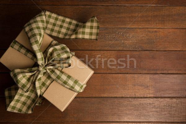 Tied gift box on wooden plank Stock photo © wavebreak_media