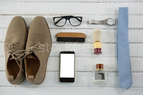 Overhead view of personal accessories on white table Stock photo © wavebreak_media