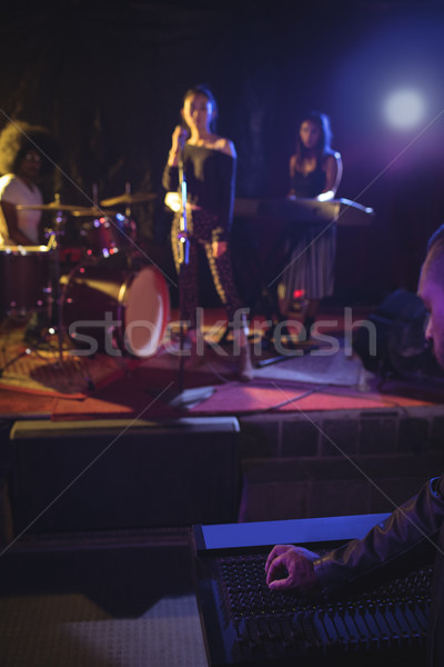 Musicians and singer performing on illuminated stage in nightclub Stock photo © wavebreak_media