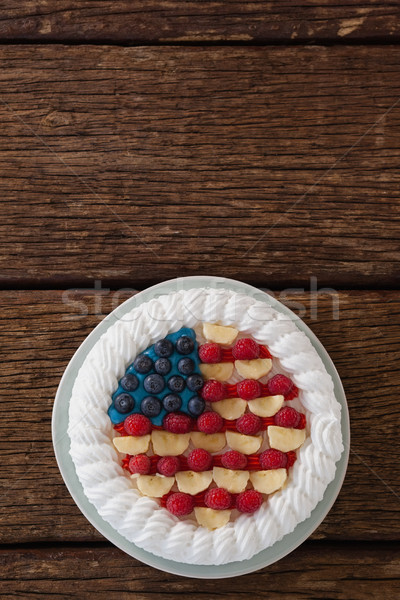 Fruitcake served in plate on wooden table Stock photo © wavebreak_media