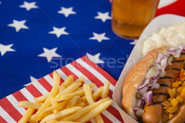 Hot dog patatine fritte legno racconto tavola Foto d'archivio © wavebreak_media