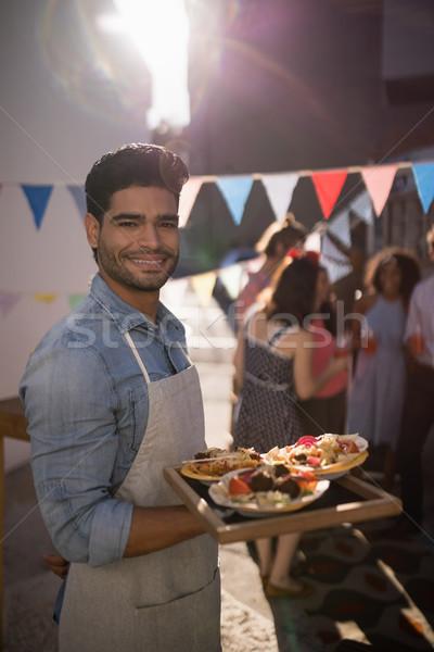 счастливым официант продовольствие лоток портрет Сток-фото © wavebreak_media