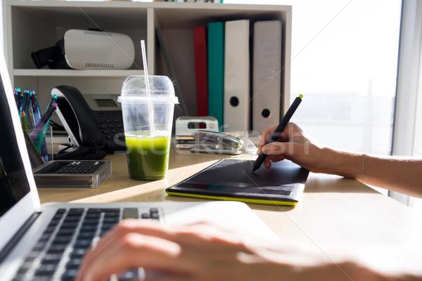 Executive using graphic tablet and laptop Stock photo © wavebreak_media