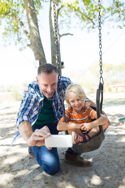 Felice padre figlio parco giochi seduta Foto d'archivio © wavebreak_media
