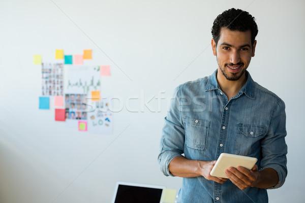 Portrait of man using tablet at office Stock photo © wavebreak_media