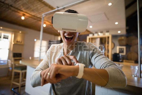 Man using virtual reality headset in restaurant Stock photo © wavebreak_media