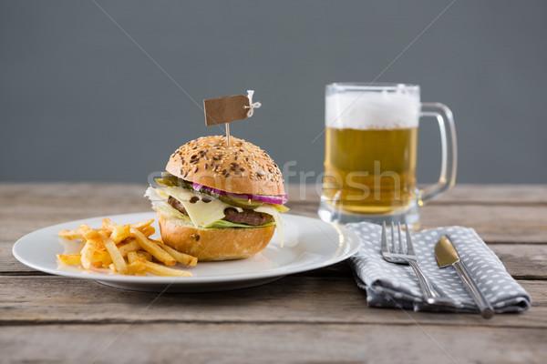 гамбургер фри служивший пластина пива стекла Сток-фото © wavebreak_media