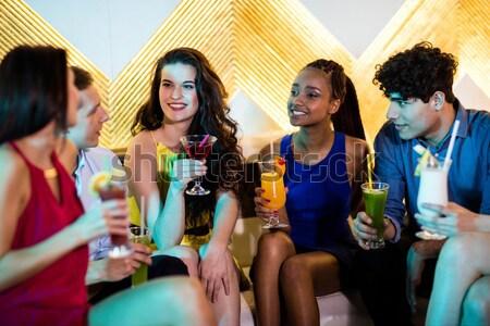 Portrait of smiling friends holding beer bottles in camper van Stock photo © wavebreak_media