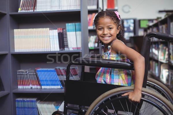 Smiling girl on wheelchair at library Stock photo © wavebreak_media