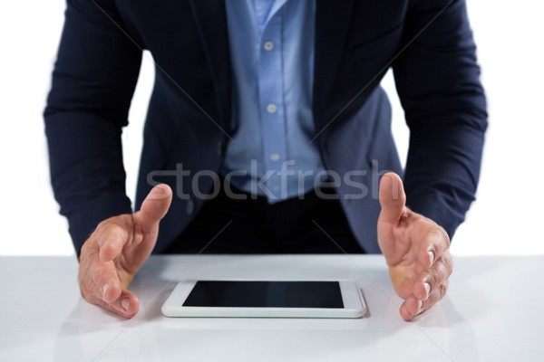 Businessman trying to hold the digital tablet Stock photo © wavebreak_media