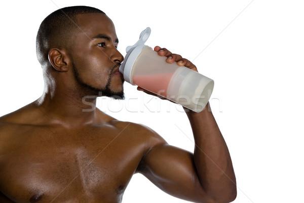Close up of shirtless sportsman having energy drink Stock photo © wavebreak_media
