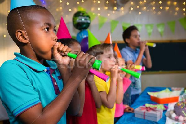 Children blowing party horns Stock photo © wavebreak_media