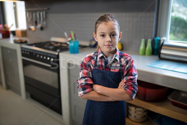 улыбаясь девушки позируют фартук кухне Сток-фото © wavebreak_media
