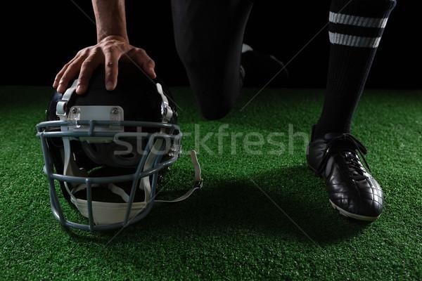 Amerikai futballista pihen kezek fej viselet Stock fotó © wavebreak_media