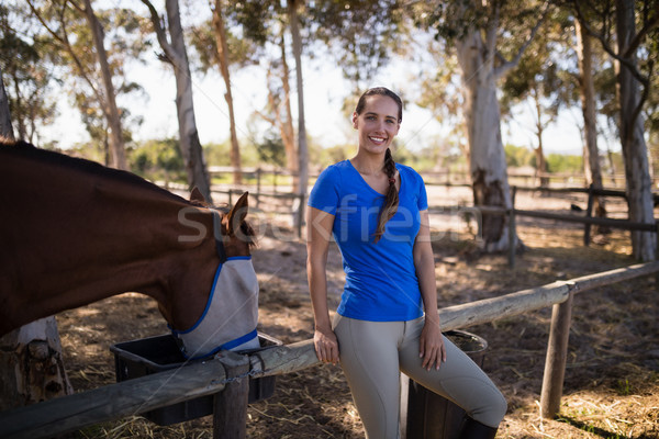 Portrait of woman standing by horse Stock photo © wavebreak_media