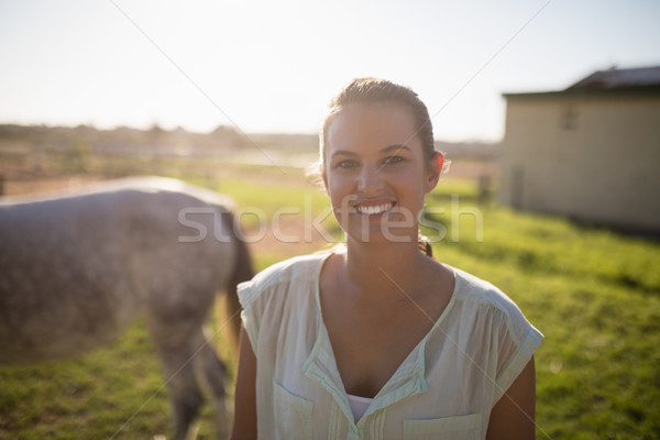 Portrait of jockey standing on field at barn Stock photo © wavebreak_media