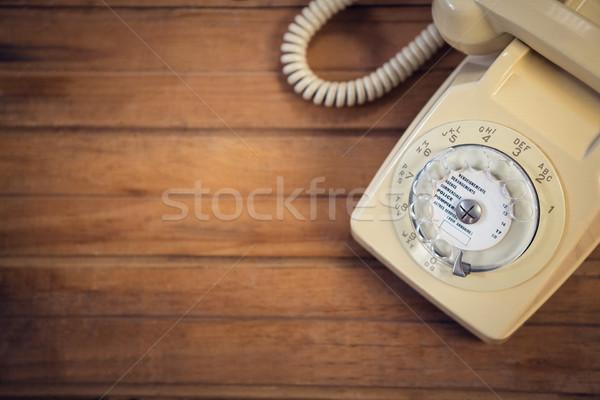 Téléphone table en bois technologie communication fil Photo stock © wavebreak_media