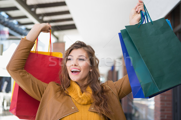 Smiling woman holding shopping bags  Stock photo © wavebreak_media
