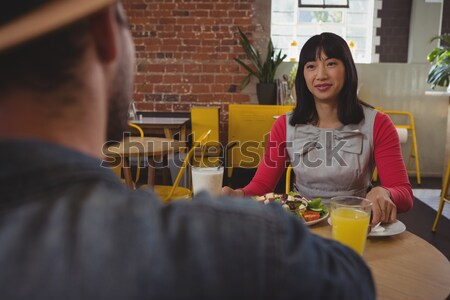 Young waitress arranging glasses at table Stock photo © wavebreak_media